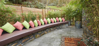 Comfortable padded seating lining a spacious outdoor area.