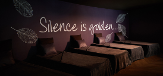 Text: ' Silence is golden'. Water beds in a relaxing darkened room.