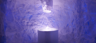 Purple iced room with a spiked funnel over a tiled pillar filled with crushed ice.